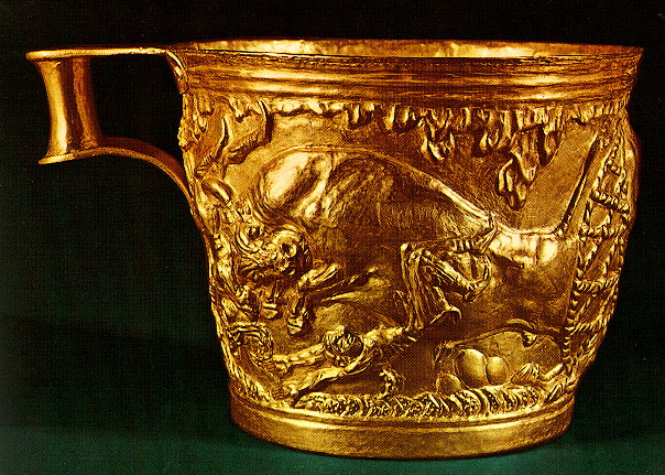 The Vapheio cups - The Vapheio cups. Pair of gold cups found in the tholos tomb of Vapheio in Laconia. The releif representations depict scenes of bull-chasing. They are unique masterpieces of the Creto-Mycenaean metalwork, dated to the first half of the 15th century B.C.